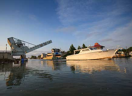 The drawbridge at Knapps Narrows on Tilghman Island in Talbot County, Maryland, raises for a fishing boat.
