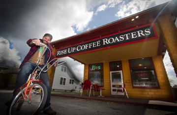Rise Up Coffee Roasters store front entrance.